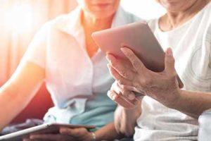 Seniors viewing tablet