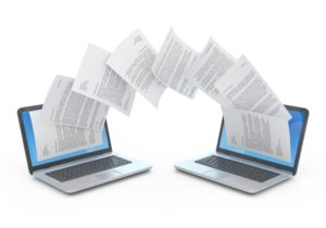 Graphic of documents transferring from one computer to another