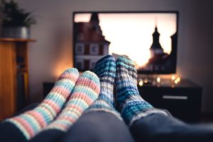 Image of fuzzy socks in front of tv